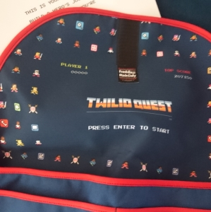 Lining of the bag shows cute 8-bit players.